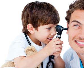 Cute child checking doctor's ears