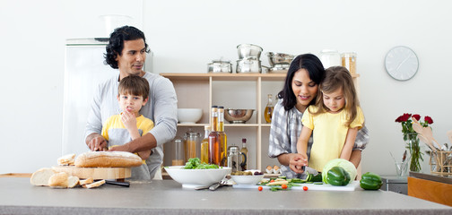 Portrait of a family preparing lunch