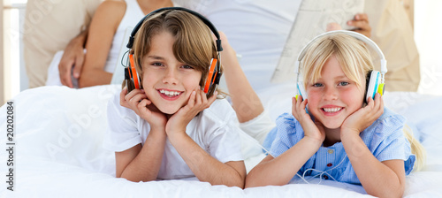 Close-up of siblings listening music