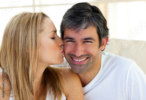 Close-up of woman kissing her boyfriend