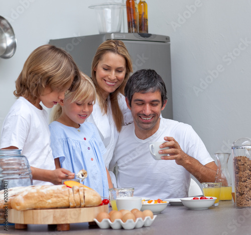 Joyful family having breakfast