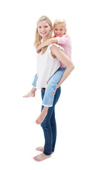 Adorable little girl enjoying piggyback ride with her mother