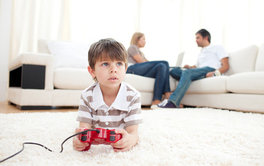 Cute little boy playing video games
