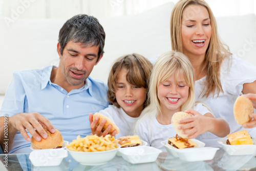 Loving family eating hamburgers