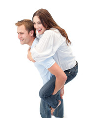 Radiant man giving his girl friend piggyback ride