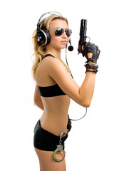 girl-agent with a gun and handcuffs