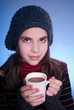 beauty girl with cup of hot chocolate