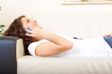 casual woman on a couch using a phone