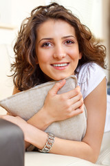 portrait of a smiling girl holding a pillow