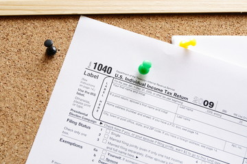 Finance concept with 1040 tax form on notice board
