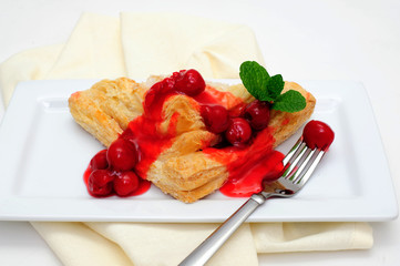 Turnover Topped With Cherries