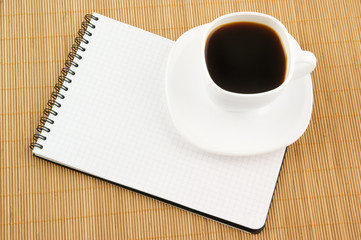 Blank pad of paper with coffee cup