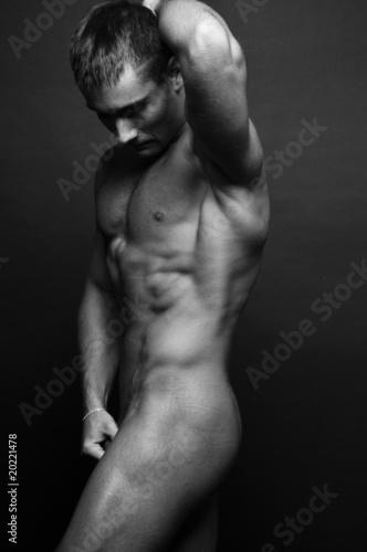 Leinwanddruck Bild Muscled male model