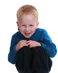 Little boy kneeling against a white background