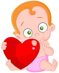 Cute Baby girl with red hair holding a heart