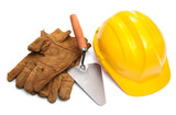 Yellow hardhat and old leather gloves isolated poster