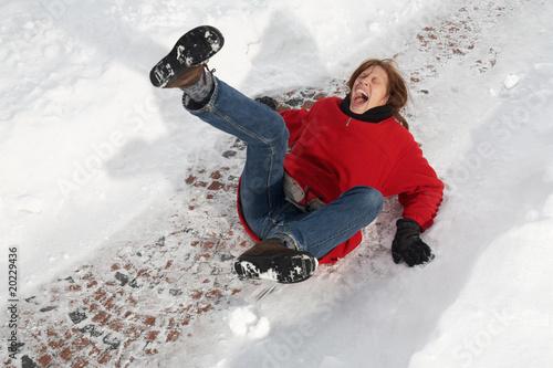Leinwandbild Motiv woman slipping on black ice
