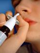 spraying nose spray