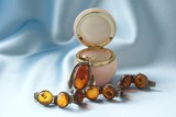 amber necklace and brooch in pink box poster