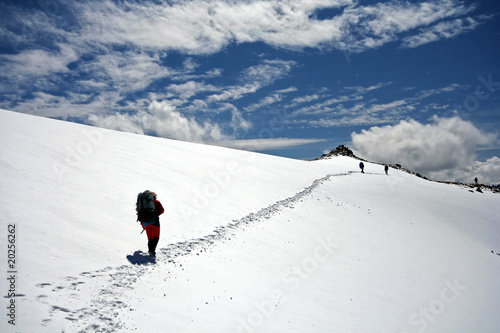 Climbers at the snow slope in Caucasus mountains