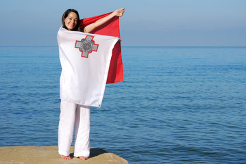 Woman wrapped in Maltese flag