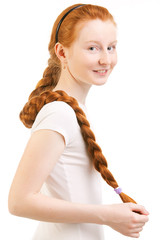 teenage girl with long red plait