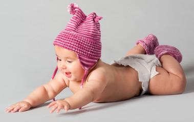 Smiling baby girl lying