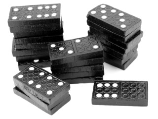 Domino stacks, black wooden tiles, isolated on white