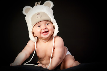 Happy baby in fun cap
