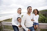 Happy African-American family with children laughing at beach - Fine Art prints