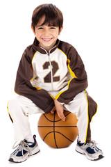 Kid stylishly sitting on the ball
