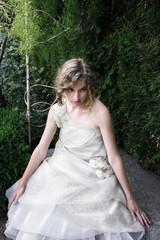 Beautiful girl sitting in the garden