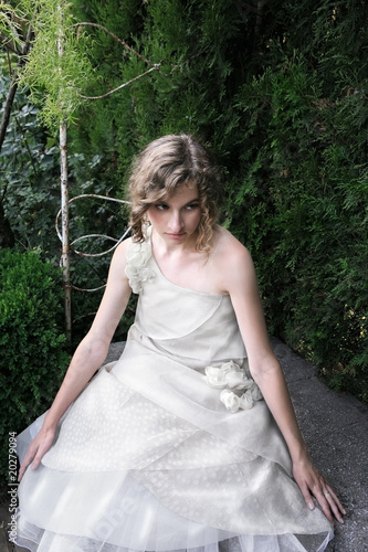 Beautiful girl sitting in the garden