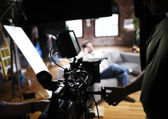 Cameraman operating digital cinema camera