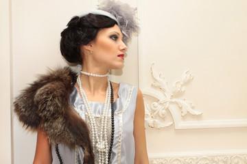 Retro styled fashion portrait of a professional model