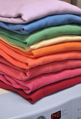Rainbow-colored laundry on washing machine