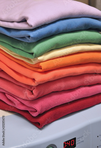 Rainbow-colored laundry on washing machine