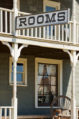 Sign for available rooms in the old western hotel