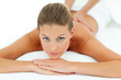 Reposing woman enjoying a massage