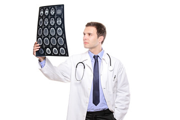A young medical doctor analyzing a CT scan isolated on white
