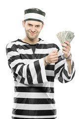 A prisoner with handcuffs holding US dollars isolated on white