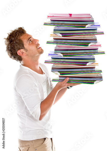 Man carrying notebooks