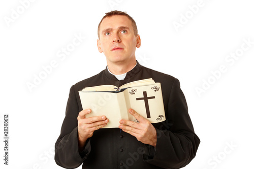 Young priest with bible