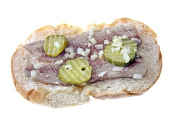 Traditional dutch sandwich with herring, onions and pickles