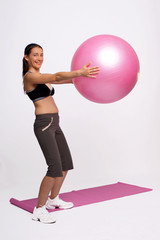 A photo of a girl doing exercises with gym ball