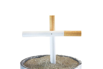 A Isolated Cigarette cross in ashtry
