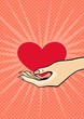 Valentine's day card with a female hand holding a heart