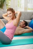 Couple doing abdominal crunch poster