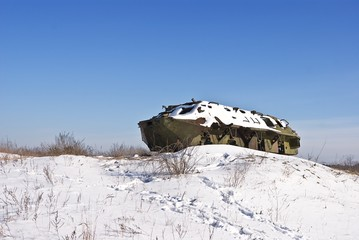 old war vehicle in a snowbound plain