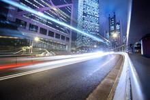 "Постер, картина, фотообои ""Fast moving cars lights blurred over modern city background"""
